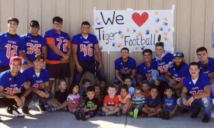 LLHS football players read to local children
