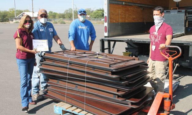 Nonprofit donates tables for Belen Schools for students