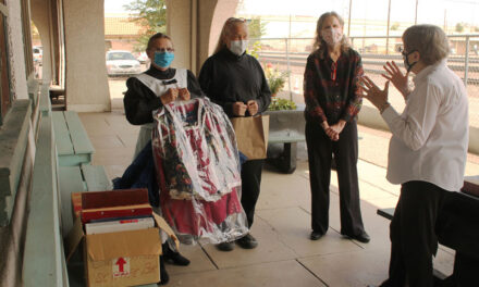 Local square dancing group donates dress to museum