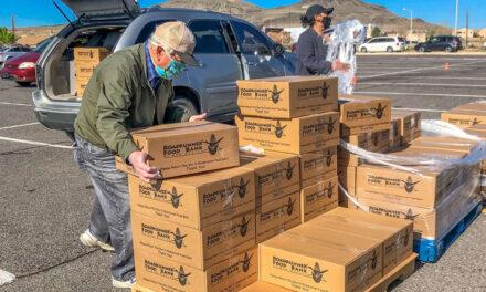 Locals help by volunteering at Roadrunner Food Bank food distribution site