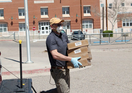 Valencia Power donates 106 laptops to Belen High School