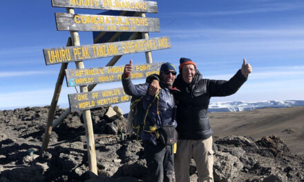 Fred Pomeroy makes his latest climb with his three daughters in Africa