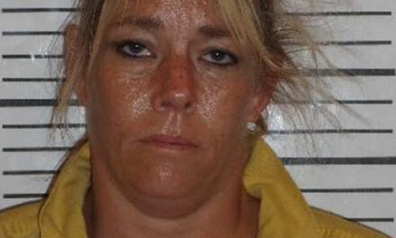 Woman charged in death of veteran