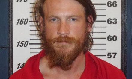 Man found dead in camper; arrest