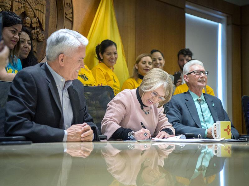 Gov signs minimum wage bill